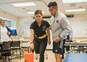 students doing physical therapy